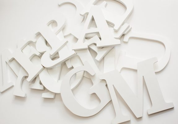 assorted+jumbled+wooden+letters+on+white