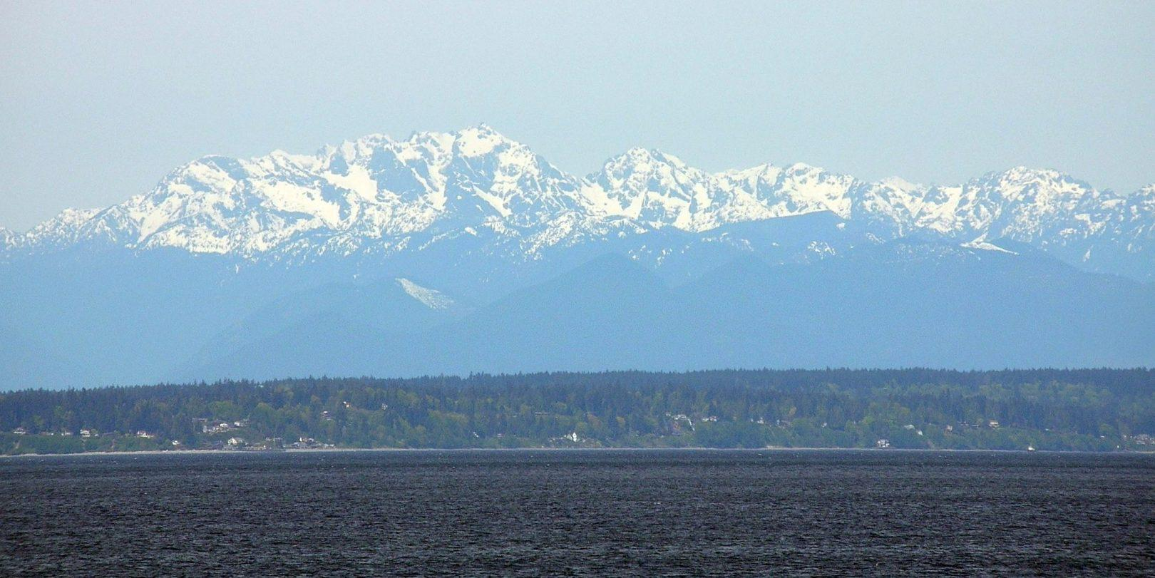 The Olympic mountains above Puget Sound, Russell's picturesque view from his commandeered plane.