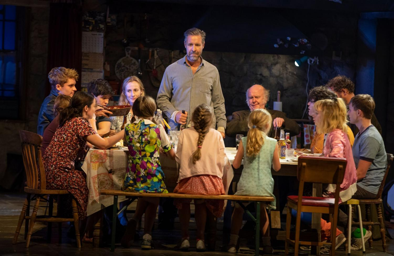 "Paddy Considine (Quinn Carney – center, standing) and the company of ""The Ferryman,"" now open at the Bernard B. Jacobs Theatre on Broadway."