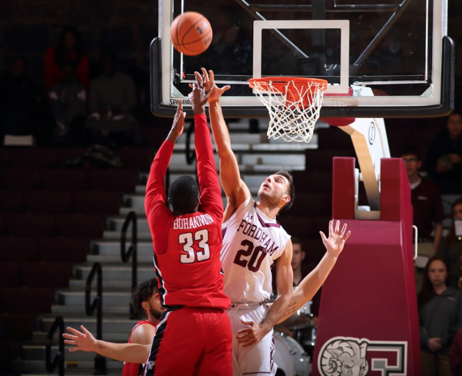 Photo+courtesy+of++Vincent+Dusovic%0AIvan+Raut%2C+Fordham+College+at+Rose+Hill+%E2%80%9921%2C+%28right%29+blocking+a+shot+from+Youngstown+State.