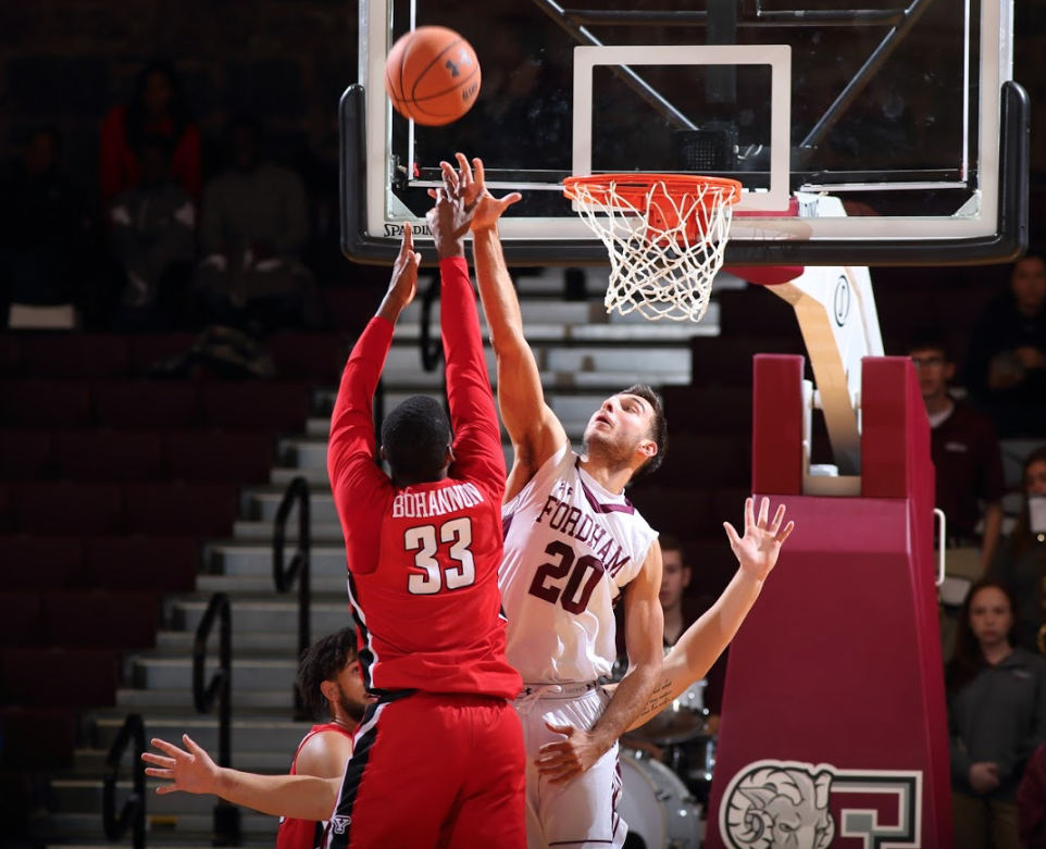 Photo courtesy of  Vincent Dusovic Ivan Raut, Fordham College at Rose Hill '21, (right) blocking a shot from Youngstown State.