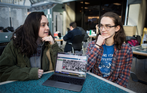 SAGES members Margaret Cohen, FCLC '20 (left), and Connor Sick, FCLC '18 and GSS '19 (right), discuss the collective nature of the website which ensures transparency in the Fordham community. (ZOEY LIU/THE OBSERVER)