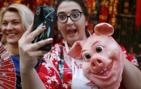 People celebrate the Lunar New Year in Chinatown on Feb. 17, 2019. This year is the year of the pig.
