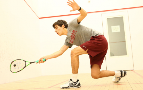 Photo Courtesy of Vincent Dusovick/Fordham Sports Info Justin Deckoff, FCRH '21, attempts a forehand stroke while warming up in the Lombardi Squash Courts.