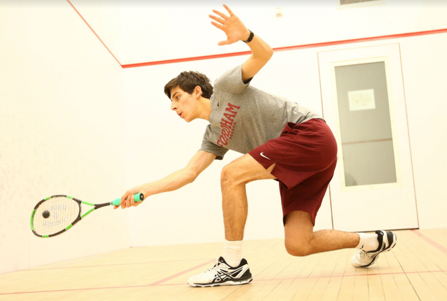 Photo+Courtesy+of+Vincent+Dusovick%2FFordham+Sports+Info%0AJustin+Deckoff%2C+FCRH+%2721%2C+attempts+a+forehand+stroke+while+warming+up+in+the+Lombardi+Squash+Courts.+