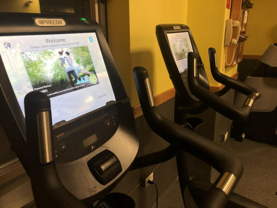 The new Precor equipment integrates touch-activated screens into the experience. Meanwhile, the  walls' new paint color is yellow.