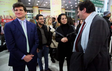 Gordon Caplan (left), and Dean Matthew Diller (right), wait at JFK international airport with Fahimeh (Farimah) Kashkooli (Center) and Fordham Law students for the arrival of Alma Kashkooli.