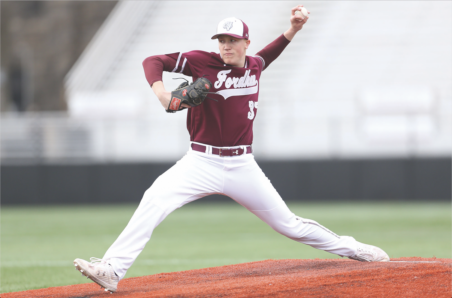Photo courtesy of Fordham Sports  Info Matt Mikulski, FCRH '21, is all business as he throws his circle change against St. Bonaventure.