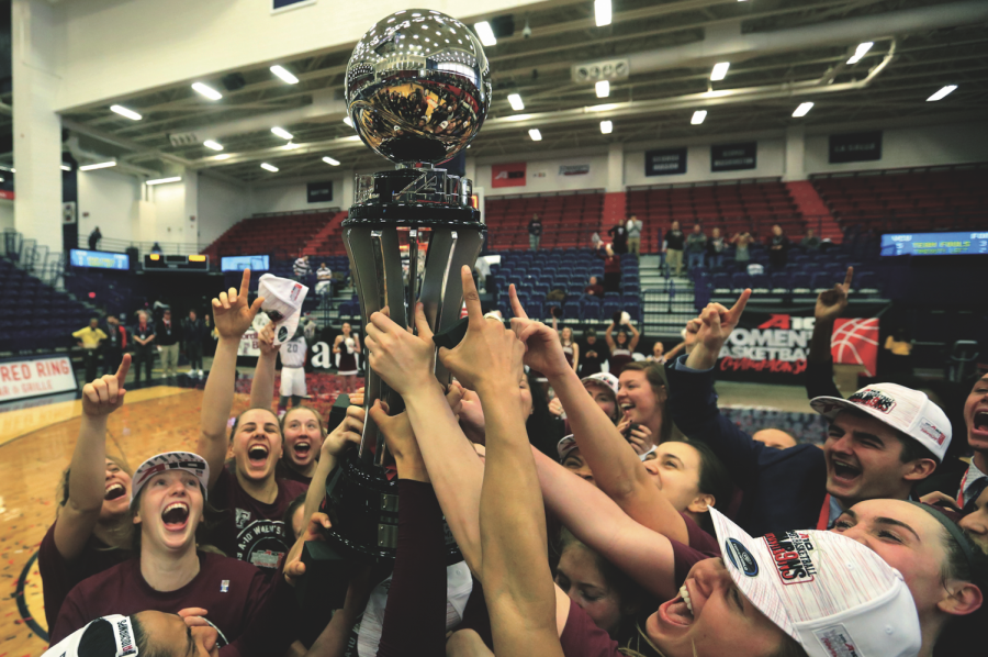 Following+a+62-47+victory+over+Virginia+Commonwealth%2C+women%27s+basketball+celebrates+their+Atlantic+10+Championship+and+automatic+NCAA+Tournament+berth.+Photo+Courtesy+of+Austin+Moriasy.