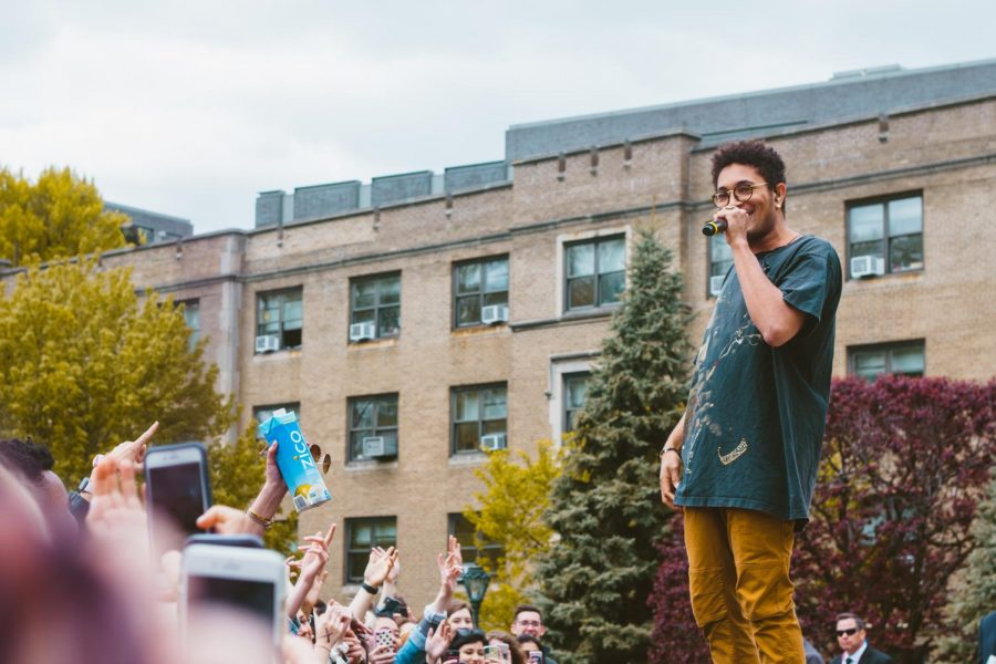 "Bryce Vine stands on speakers to look over a sea of Fordham students, or in his words, ""the most lit day party I've ever seen for a group of sober people."""