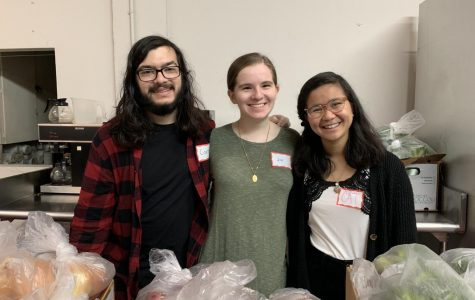 Corbin Gregg, Jill Rice and Cat Fernando volunteer at the Metro Baptist Church food pantry.