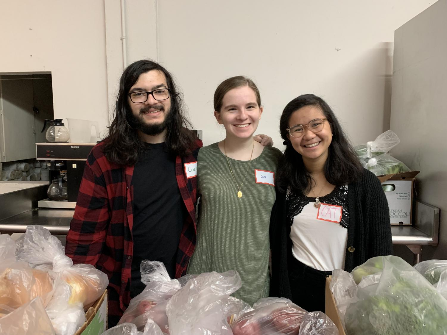 Corbin Gregg, Jill Rice and Cat Fernando volunteer at the Metro Baptist Church food pantry.
