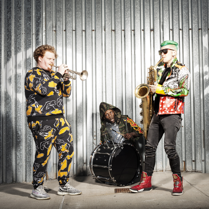 Too+Many+Zooz+mixes+dub%2C+soul%2C+funk+and+ska+in+their+music+for+a+refreshingly+unique+sound.