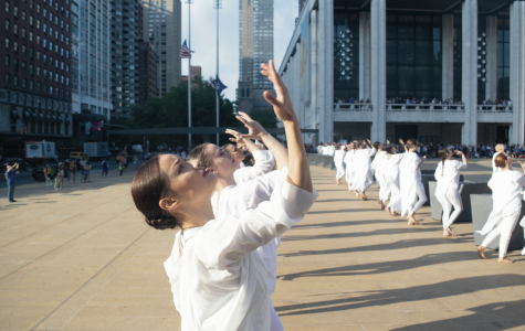 The dancers raised their hands for one minute of silence at 8:46 a.m.