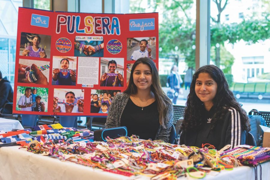 Members of SOL sell colorful bracelets from Nicaragua and Guatemala to raise money for communities in Central America as part of the Pulsera Project.