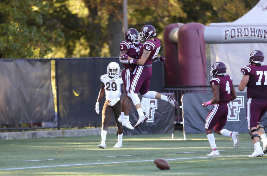 Trey Sneed, Fordham College at Rose Hill (FCRH) '21 and Jeff Ciccio, FCRH '23 celebrate a score against Lehigh.