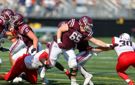 Football Faces Fears, Takes Down Spiders in 23-16 Victory