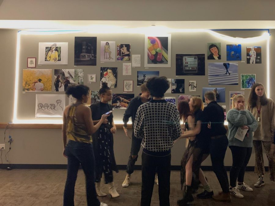 Students gathered in G76 to admire student art and writing at