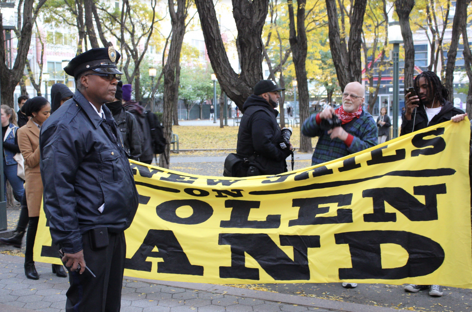 NYPD officer at emergency action protest on Nov. 1.