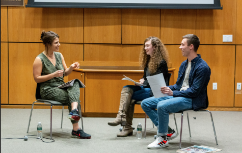Lauren Duca, left, sits with the current Editors-in-Chief of the paper