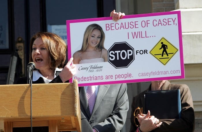 Diane Anderson holds up her daughter's image to fight for a new pedestrian safety law in New Jersey. The law was passed on April 1, 2010.