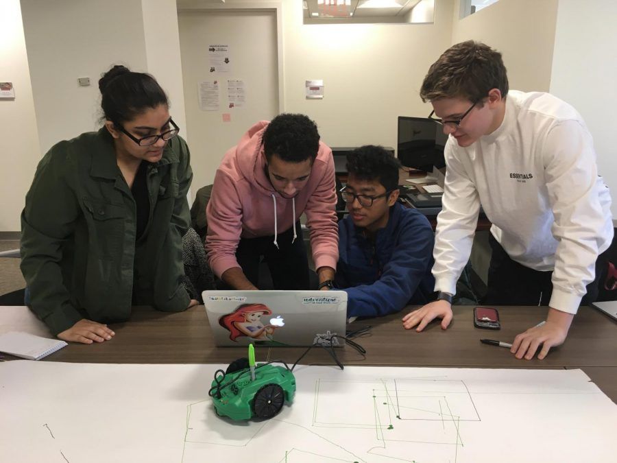 Fordham+Lincoln+Center+students+collaborate+to+code+for+their+robot.+