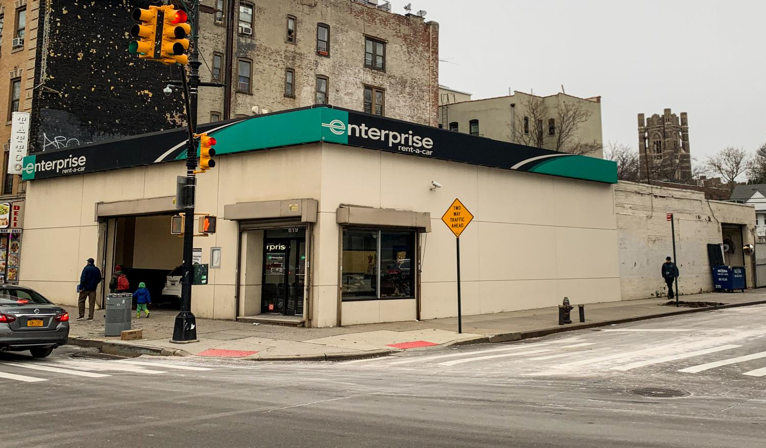 Enterprise Rent-A-Car will continue to lease the building from Fordham University while expansion plans are considered.