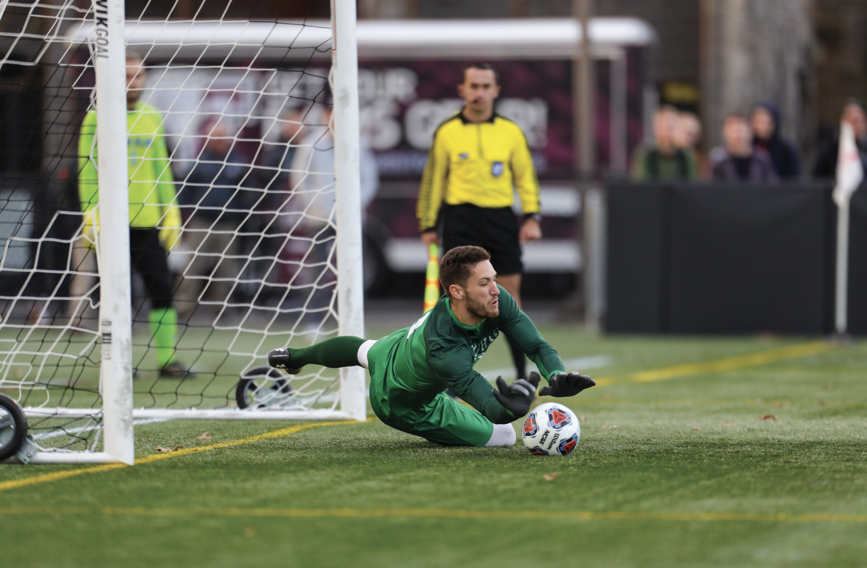 Goalkeeper Konstantin Weis, GGSB '20, saved a penalty to keep the Rams in the quarterfinal match against SLU.