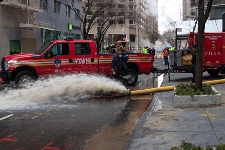 Firefighters+and+City+Employees+worked+to+repair+the+damage+of+the+ruptured+water+main+on+62nd+Street+and+Broadway+avenue.