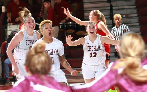 Bre Cavanaugh, FCRH '21, celebrates with her team after hitting a three-pointer in the final seconds to defeat Davidson.