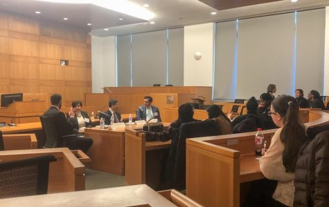 The Honorable Maria Araujo Kahn '89 (center-left) and Denny Chin '78 (center-right) share their experiences before an audience of first-generation students and alumni in the Gorman Moot Courtroom.