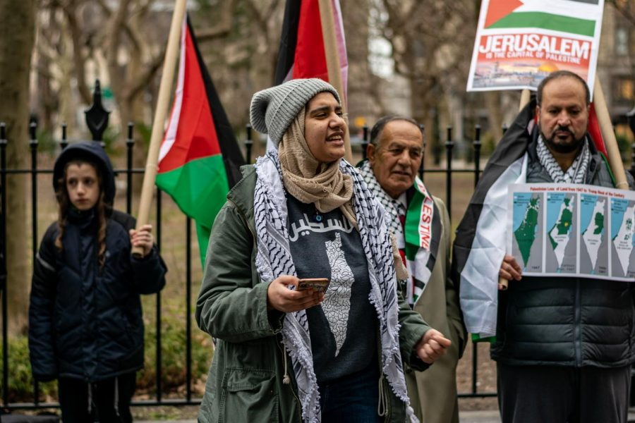 former president of Fordham SJP, Batool Abdelhafez, speaks at a rally for Palestine