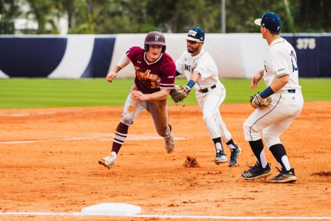 Billy Godrick, FCRH '20, unsuccessfully tries to advance to third base in Fordham's third game against FIU.