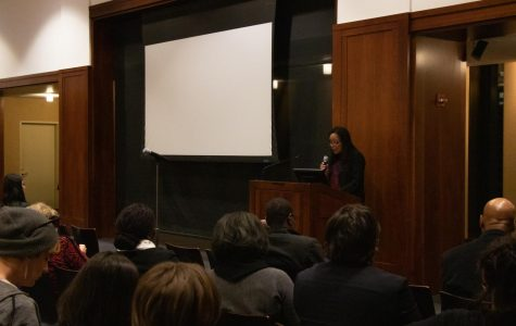 A scholar of African American literature reads portions of her book to portray ideas about race theory.