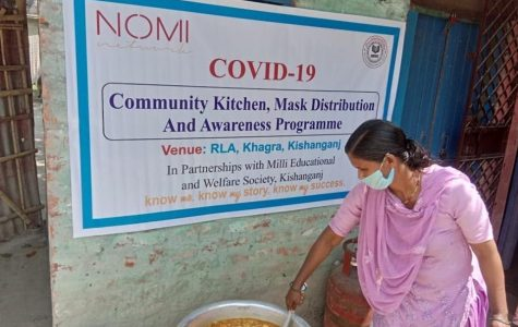A woman serves food as part of the Nomi Network response in India