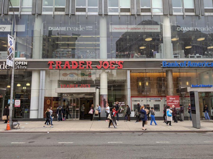 Shoppers wait in line outside Trader Joe's on 72nd Street.
