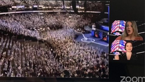 Two people zoom over a crowd
