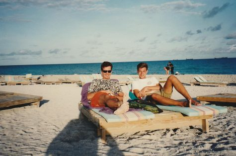 Anderson and hake laying on the beach