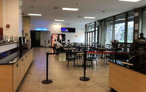 The Ram Cafe empty of students while workers take a break at the tables in the back