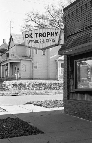 "Street corner with ""OK TROPHY"" Store sign"