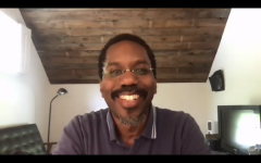 a ZOOM screenshot of Professor Capers smiling