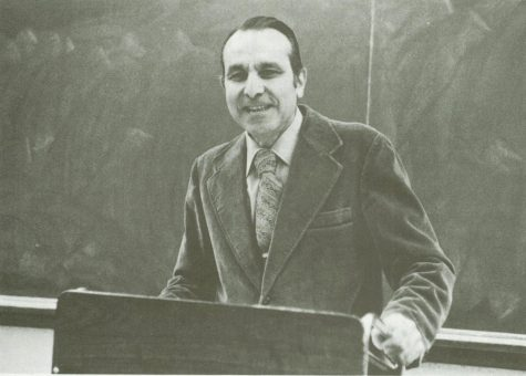 Professor Cammarosano at a podium in front of a chalkboard