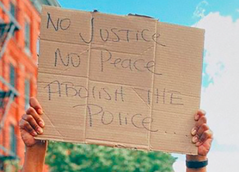 "sign that says ""no justice, no peace, abolish the police"""