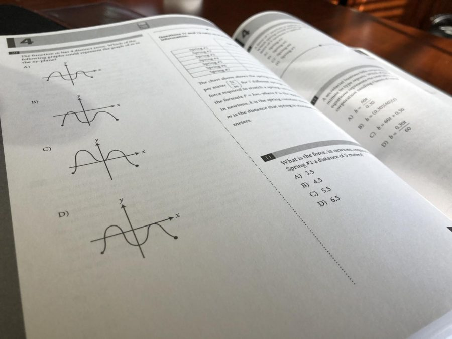an SAT test practice book displaying graph problems