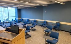 A classroom in the Gabelli school with chairs sparsely populating the room