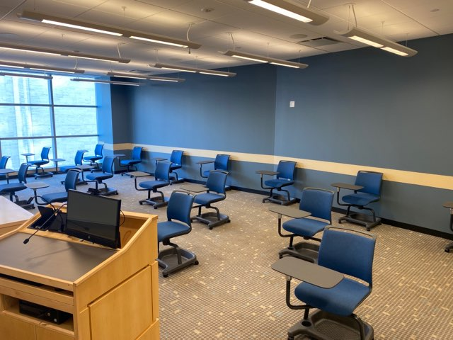 A+classroom+in+the+Gabelli+school+with+chairs+sparsely+populating+the+room