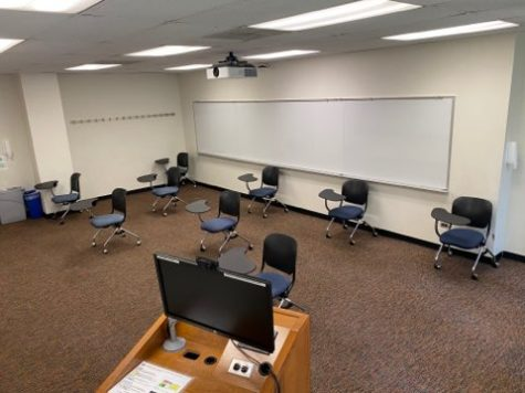 A Lowestein classroom set up for social distancing with only 9 desks, all at least 6 feet apart