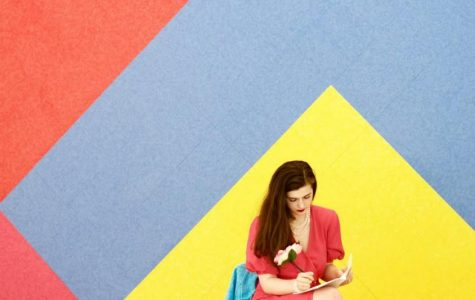 Cathleen Freedman writing in front of colorful wall