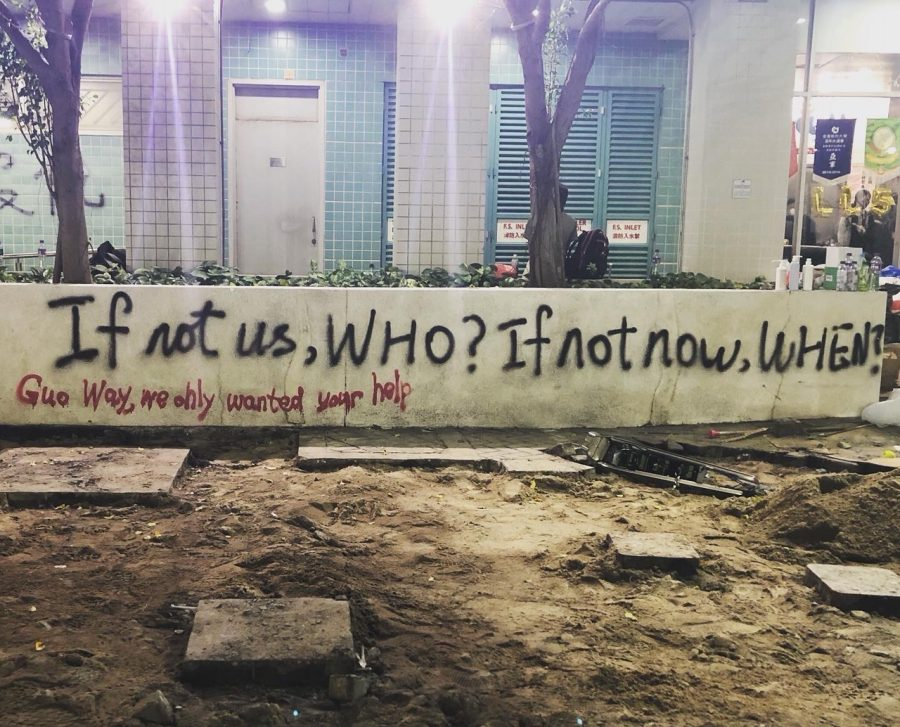 "a wall with graffiti in Hong Kong reading ""if not us, WHO? If not now, WHEN?"" below is more graffiti reading ""Guo Way, we only wanted your help"""