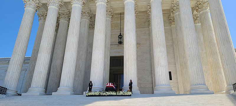 Ruth Bader Ginsburg in a coffin on the front of the Supreme Court building